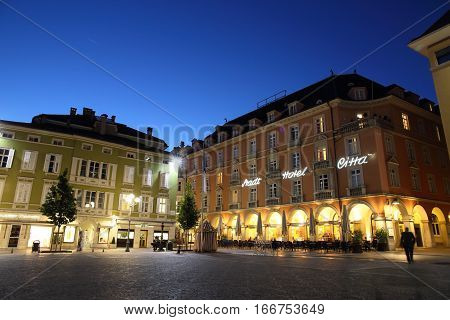 BOLZANO, ITALY - OCT 13, 2016: Night cityscape of market square in Bolzano, Italy on Oct 13, 2016. It is a landmark city near the Dolomites alps.