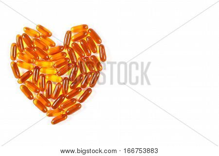 Heart Shaped Medical Pills And Capsules On White Background, Health Care Concept, Copy Space For Tex