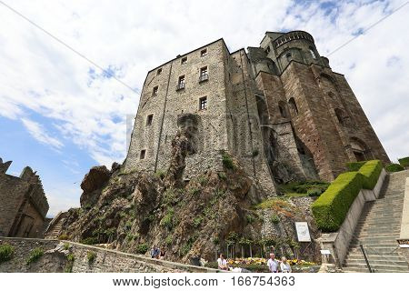 VAL DI SUSA, ITALY - MAY 25, 2016: Sacra di San Michele on May 25, 2016 in Val di Susa, Italy. It is a landmark pilgrimage site in Italy.