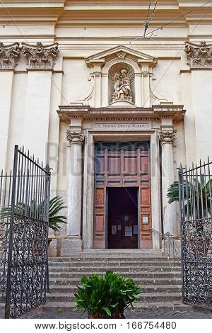 entrance door to the church Santa Maria della Scala located in the Trastevere district, Rome, Italy