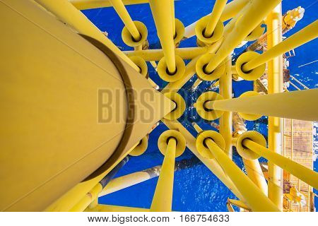 Oil and gas production casing and tubing in well slot at oil and gas wellhead remote platform
