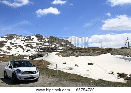 POSCHIAVO, SWITZERLAND - MAY 27, 2016: Alpine scenery of Bernina Pass at Poschiavo on May 27, 2016 in Switzerland. It is a landmark alpine pass connecting Italy and Switzerland.