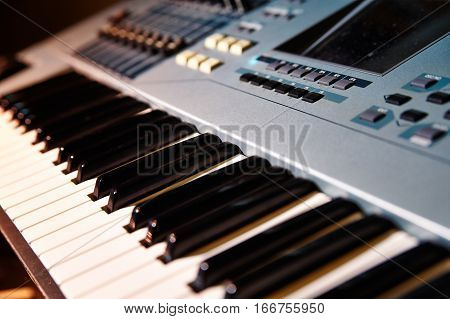 Piano close up black and white Piano keyboard background with selective focus studio music synthesizer keyboard side view of instrument musical tool