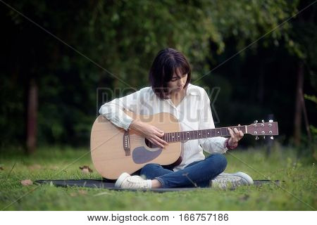 Playing Guitar In Park