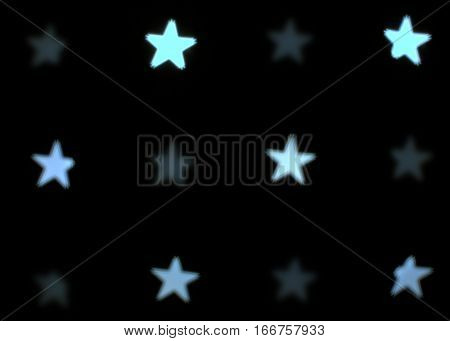 pattern of stars five pointed white bokeh effect dark black background