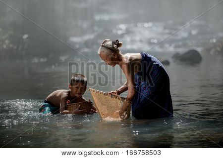 grandmother and nephew fishing in creek happily countryside life style poster