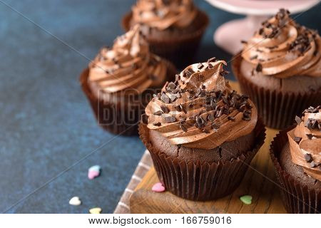 Chocolate cupcakes on a blue background close up