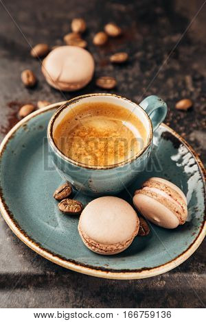 Macaroon and Coffee. Espresso coffee and delicious french almond macaroons.