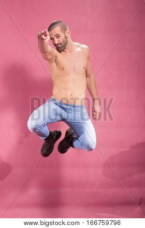 Man Jump In Air, Pink Background