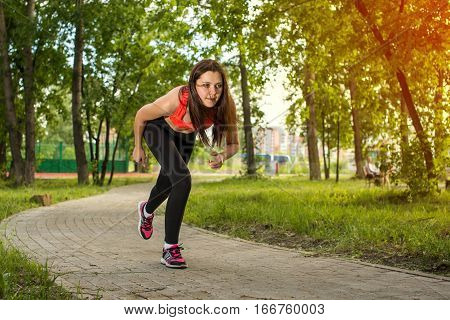 Beautiful Young Lady Going To Run In Park