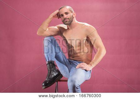 Man Posing Pink Background Shirtless Muscular Sitting Stool