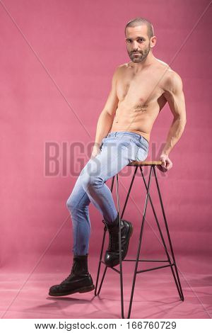 Young Adult Man Posing, Pink Background