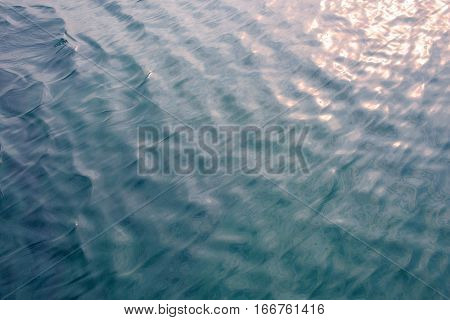 Ripples On The Water Surface With Reflection Of Sky