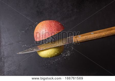 Knife And Apple Cut Are Frozen In Mid Air