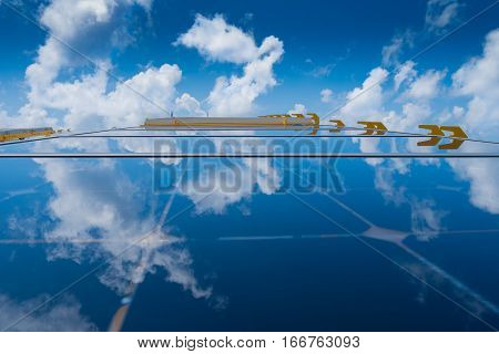Solar cell Energy white cloud and blue sky reflect on solar cell panel at offshore oil and gas field.