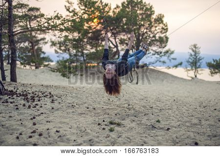 Cute, Young Girl On A Swing