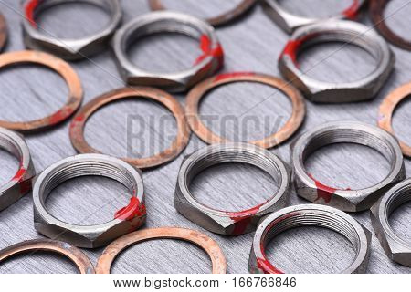 Nuts and washers tool on metal background