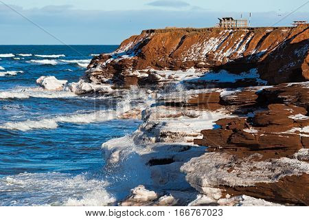 Winter view of the surf and cliffs in the Prince Edward Island National Park.
