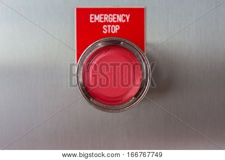 Emergency stop push button switch of gas booster compressor on stainless steel junction box (close up)