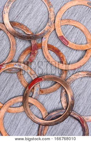 Old Copper Washers on Metal Background, Top View