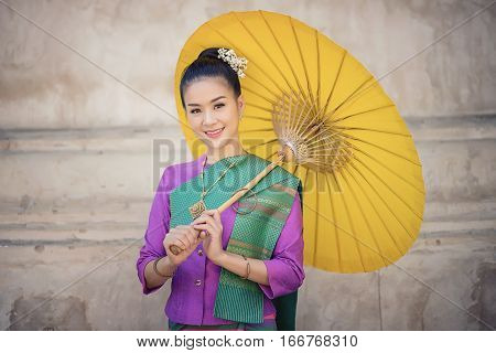 Portrait Of Beautiful Thai Women In Lanna Traditional Costume,  With Umbrella Vintage Style In Chian