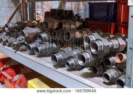 Alloy Steel Threaded Fittings on the shelf in warehouse facilities.