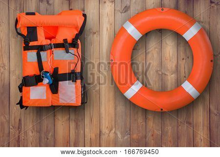 Life Buoy And Life Jacket Hanging On Wooden Wall For Emergency Response When People Sinking To Water