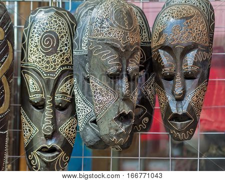 Original Souvenirs : theatrical masks made of wood and symbolizing a variety of emotional States.