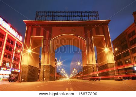 car through Arch gate at night