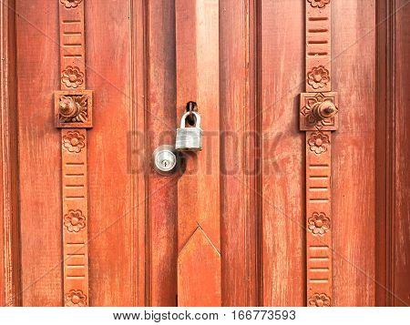 Old wooden entrance doorway. Handmade door with lock.