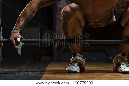 Male Athlete Preparing For Exercise With Barbell