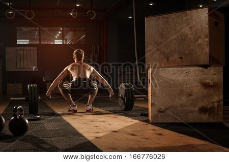 Young Muscular Man Doing Barbell Workout