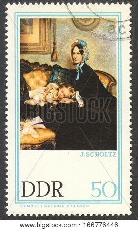 MOSCOW RUSSIA - CIRCA DECEMBER 2016: a post stamp printed in the DDR shows the painting