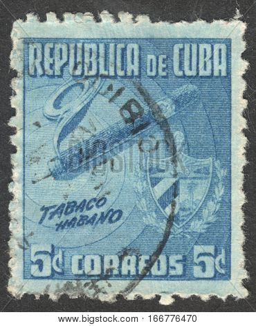 MOSCOW RUSSIA - CIRCA DECEMBER 2016: a post stamp printed in CUBA dedicated to Havana Tobacco Industry circa 1948-1950