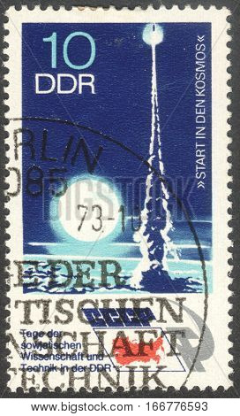 MOSCOW RUSSIA - CIRCA DECEMBER 2016: a post stamp printed in the DDR shows Rocket Launching the series