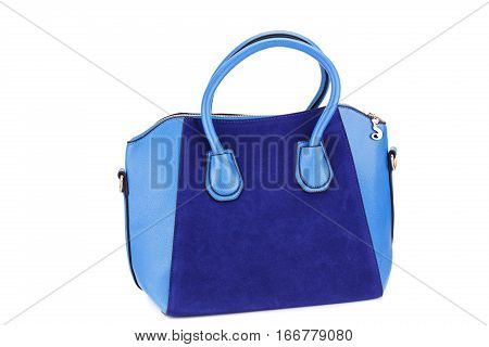 Blue leather handbag isolated on white background.