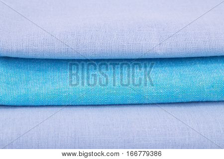 Stack of blue kitchen towels closeup picture.