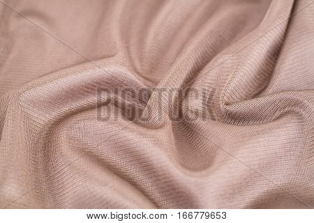 Brown silk fabric texture as a background.