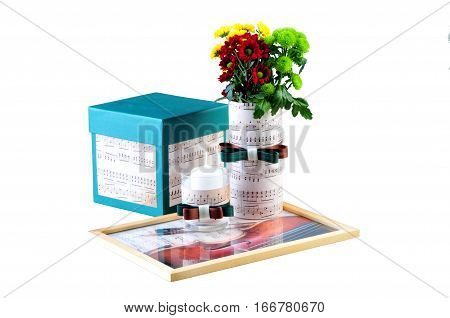 Ukraine Kiev - January 25 2017: Romantic composition made of candle flowers songbook and box with a present- illustrative editorial.