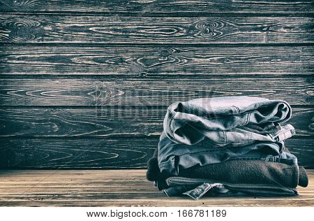 Old clothing on wood desk. Concept second hand