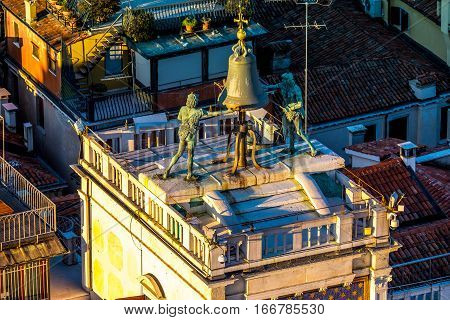 Zodiac clock in Venice, Italy. Clock Tower with  two moors striking the bell - early Renaissance (1497) building in Venice, located the north side of Piazza San Marco, Italy. Aerial view.