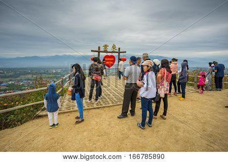 MAE HONG SON, THAILAND - JAN 2, 2017: Many people sitting at the viewpoint and waiting to see the sunshine on the morning at YUN LAI viewpoint, Thailand on January 2 2017, in MAE HONG SON, THAILAND