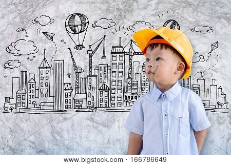Little engineer thinking many ideas with world city doodles elements background,Concept of a small creative engineer.