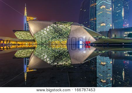 GUANGZHOU CHINA - DECEMBER 10 2016 : Guangzhou Opera House and reflection on the water at night landscape on Dec. 10 2016