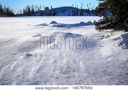 Ice surface of the Stbske Pleso lake. Is a picturesque mountain lake of glacial origin and a top tourist destination in the High Tatras Slovakia.