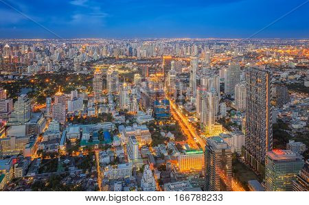 Sunset and night city scape View poit of Bangkok from Mahanakorn tower Silom area Thailand