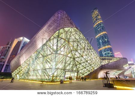 GUANGZHOU CHINA - DECEMBER 10 2016 : Guangzhou Opera House and Business building at night landscape on Dec. 10 2016