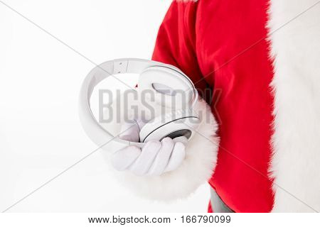 Cropped image of Santa Claus hand showing headphones