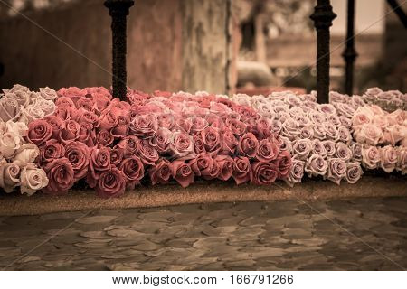 A beautiful bouquet of autumn roses on a patio.