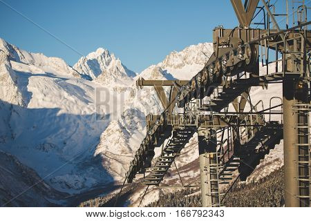 Ski lift construstion in caucasian mountains Dombay